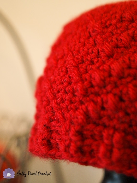 Closeup photo of the detail stitching in the Chevron puff hat.