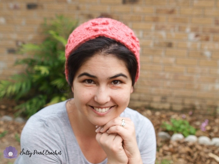 Find this free crochet ear warmer pattern, the Chunky Cabled Heart Earwarmer, on SaltyPearlCrochet.com!
