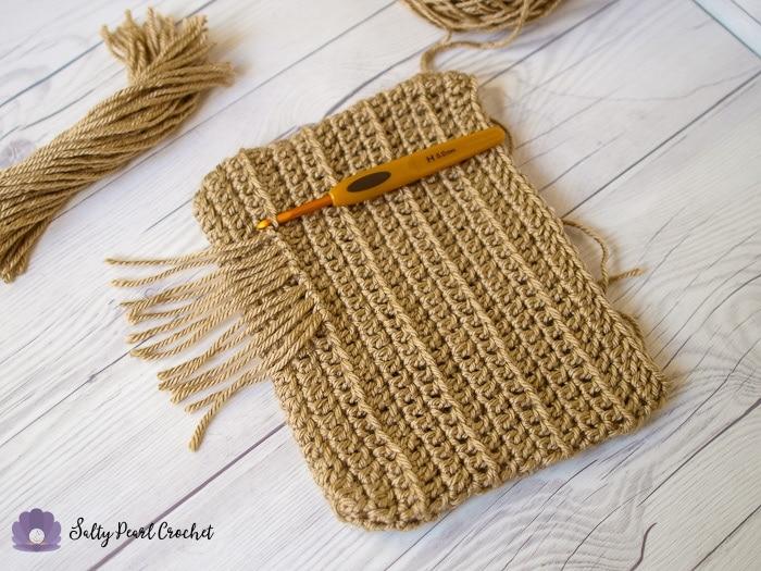 Adding fringe to the Crochet Fringe Clutch Purse