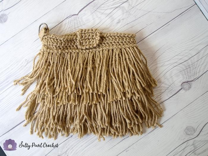 Crochet Fringe Clutch Pattern in tan Red Heart Soft Yarn