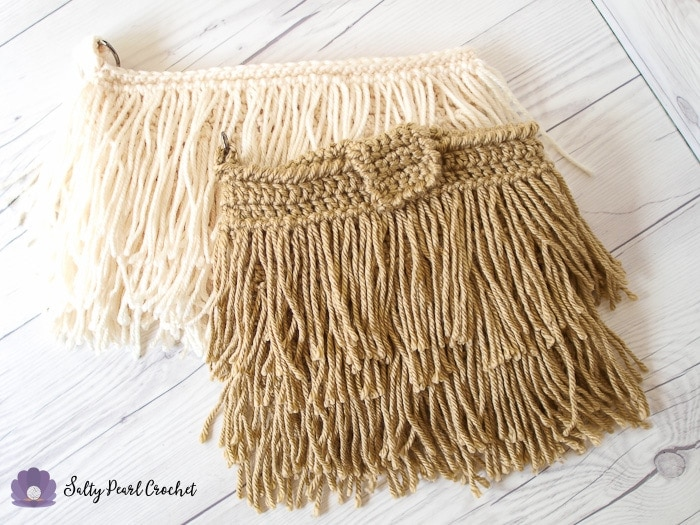 Two fringed clutch crochet purses in off white and tan