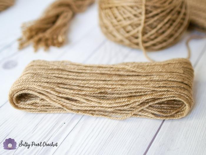 Yarn ready to cut into fringe