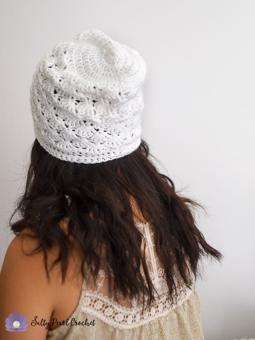 Woman wearing a crochet slouch hat seen from behind