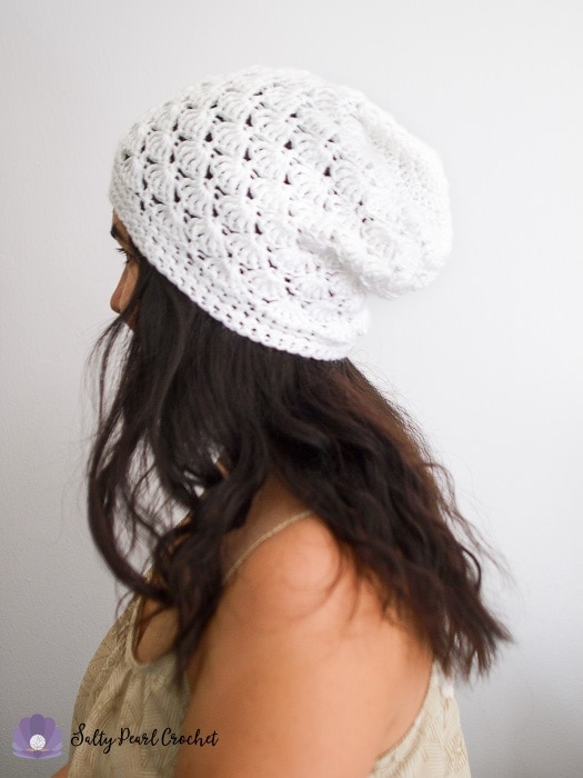 Side profile of a woman wearing a crocheted slouchy beanie