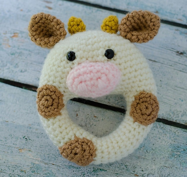Close up photo of a cute crochet cow baby rattle