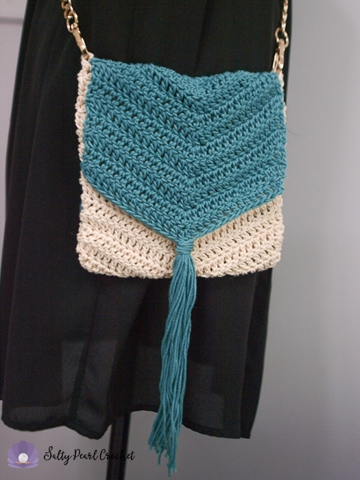 A Boho Chevron Crochet Purse Displayed on a mannequin.