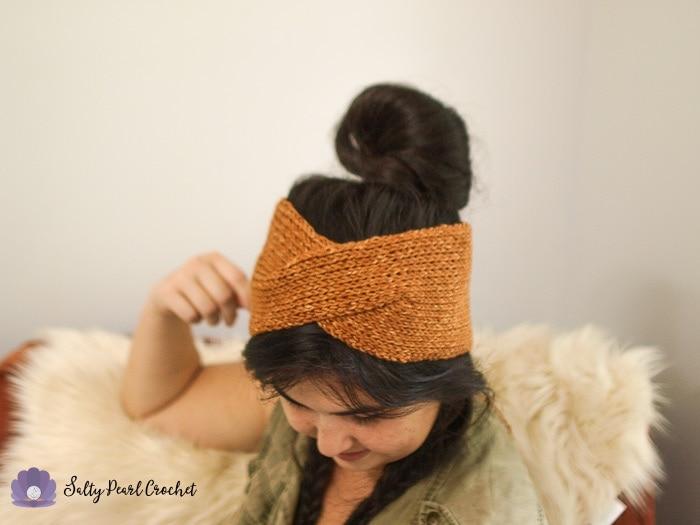 Wide shot of woman wearing an orange boho crochet headwrap