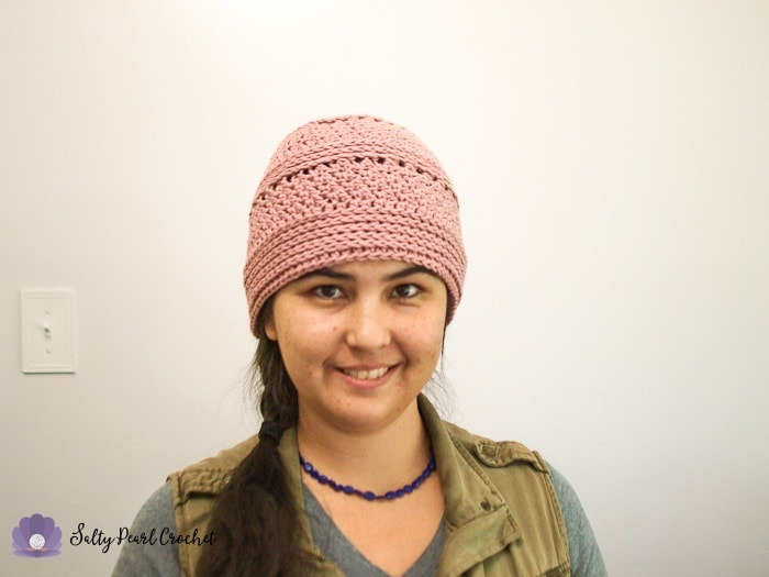 Woman smiling wearing a pink hat made from Linda's Easy Crochet Chemo Cap Pattern