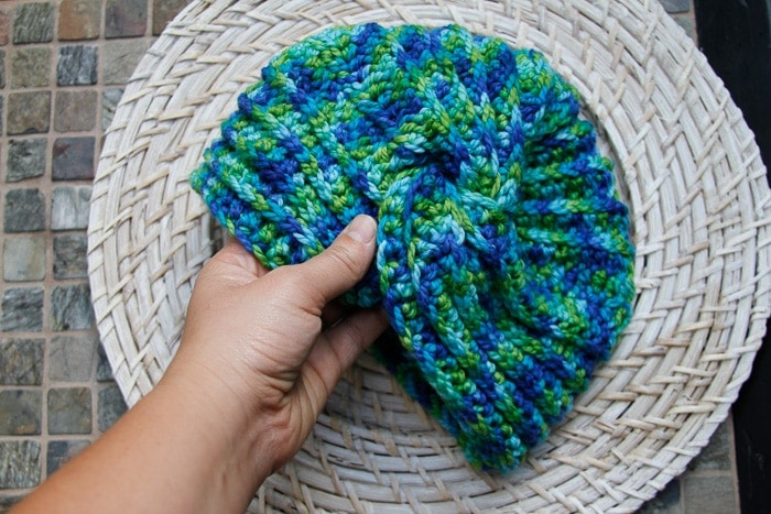 Hand holding a textured turban crochet pattern sample
