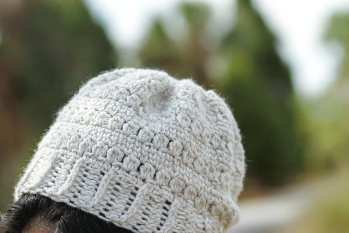 Close up photo of a crochet beanie hat.
