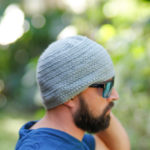 Guy with a beard wearing a mens crochet herringbone stitch hat.