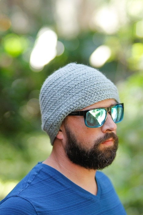 Man wearing a crochet herringbone stitch hat.