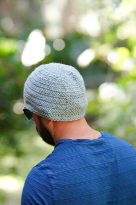 Photo of a man wearing a herringbone stitch crochet beanie.