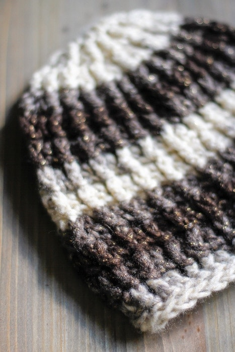A close up photo of a textured crochet hat pattern.
