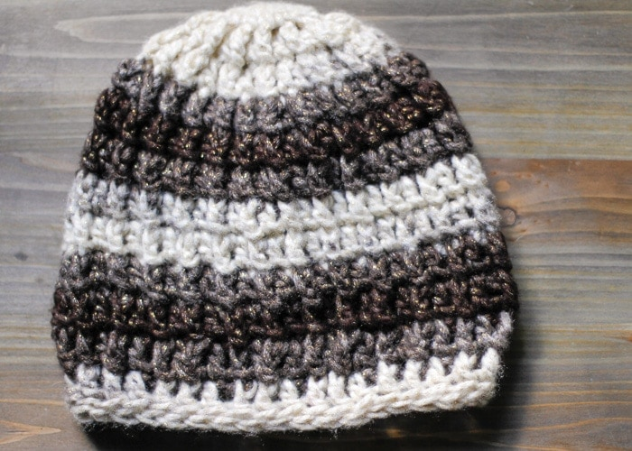Easy crochet cable hat laid flat on a desk.