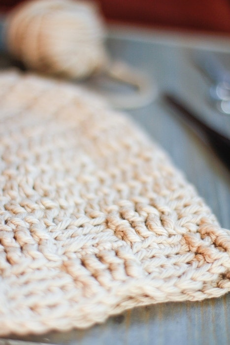 Closeup of the crochet basketweave stitch texture on a crochet beanie pattern.
