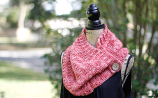 Side view of Clearwater beach buttoned cowl crochet pattern displayed on a mannequin