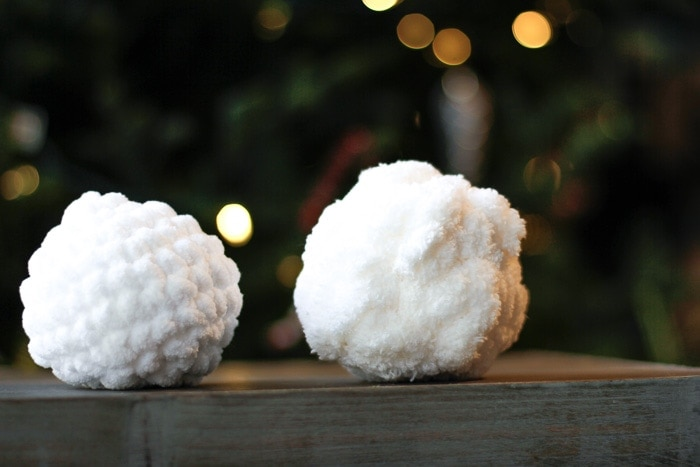 A crochet snowball made with Bernat Blanket Yarn on the left, compared to a Mainstays Chenille Chunky yarn crocheted snowball on the right.