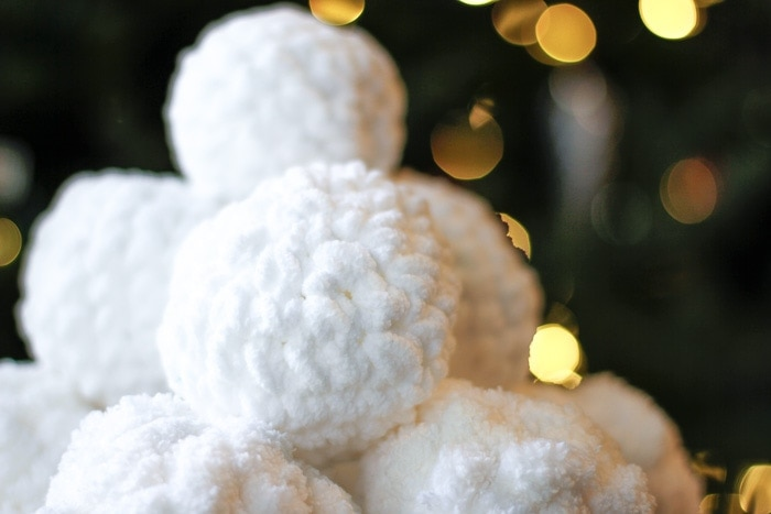 A pyramid of crocheted snowballs.
