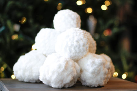 Stack of Crochet snowballs for an indoor snowball fight.