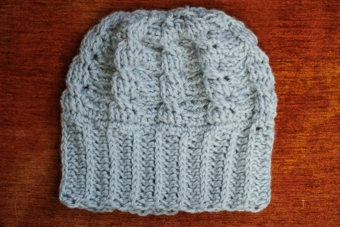 Close up photo of the mintberry crunch easy crochet cable hat pattern.