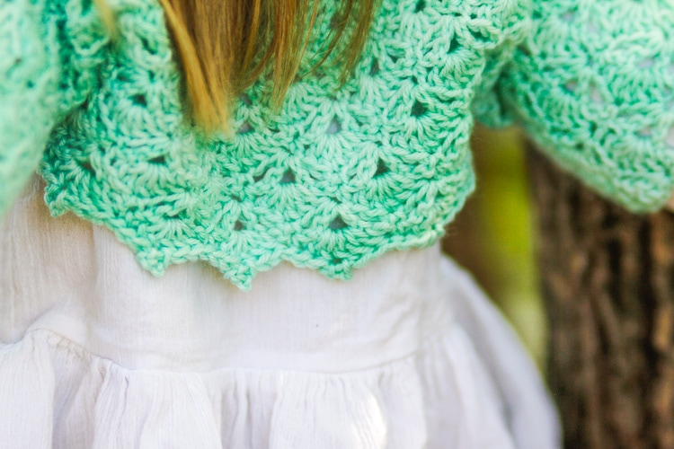 Close up of the mermaid tears crochet bolero lace stitching in green yarn