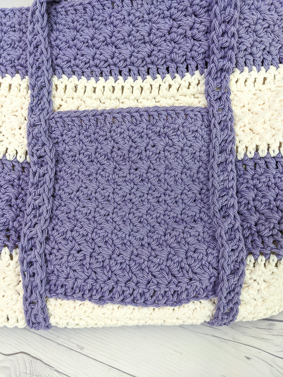 Close up of the pocket on the side of this crocheted bag pattern showing the assembly.