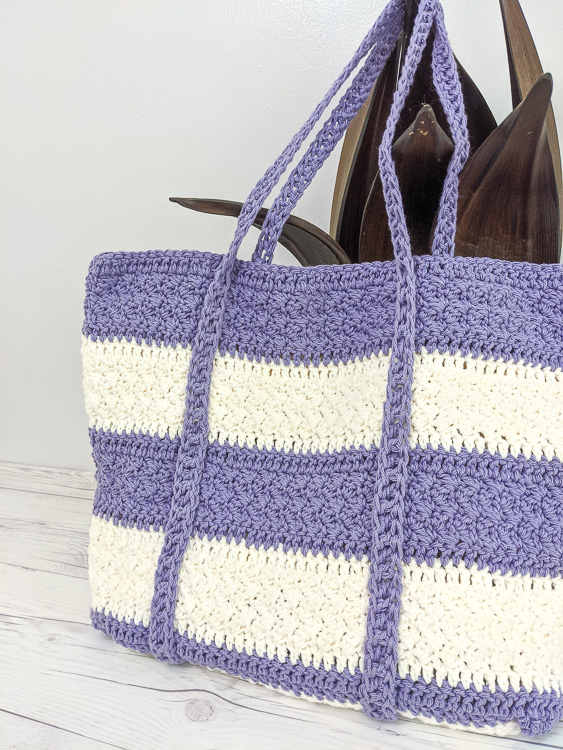 Closeup of the white and purple striped Largo Tote Bag shown without a pocket.
