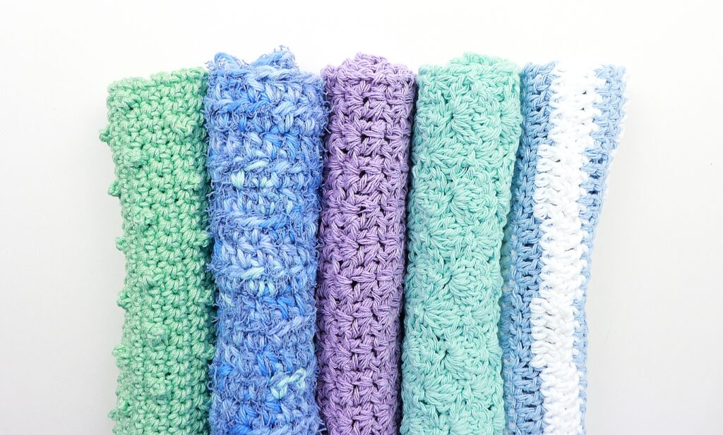 5 crochet dish cloths in various colors