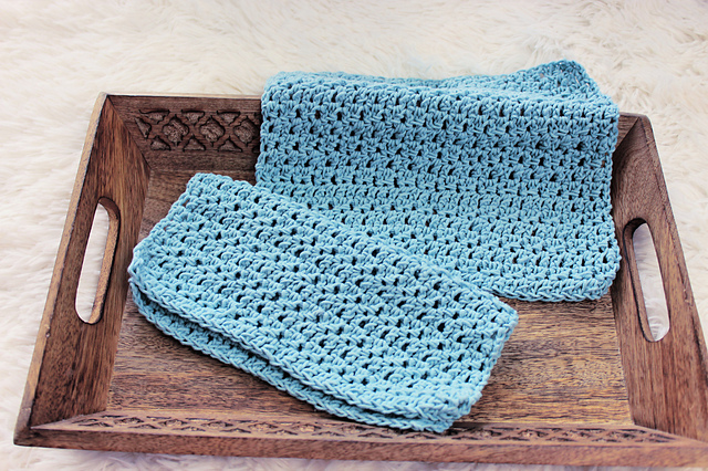 two crochet wash cloths in a wooden tray