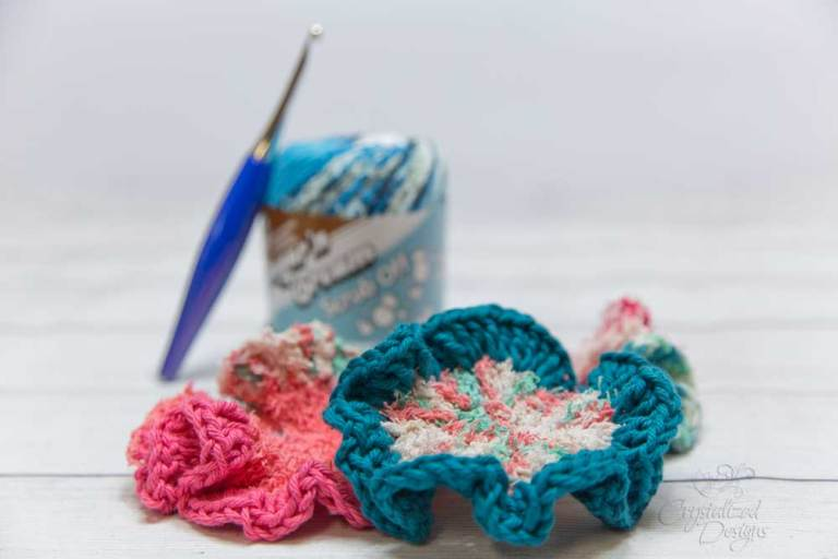 Brightly colored crochet scrubbies with scrubby yarn and a crochet hook
