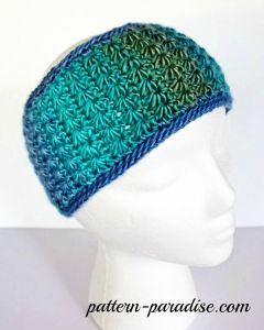 A crochet headband pattern displayed on a white foam head.