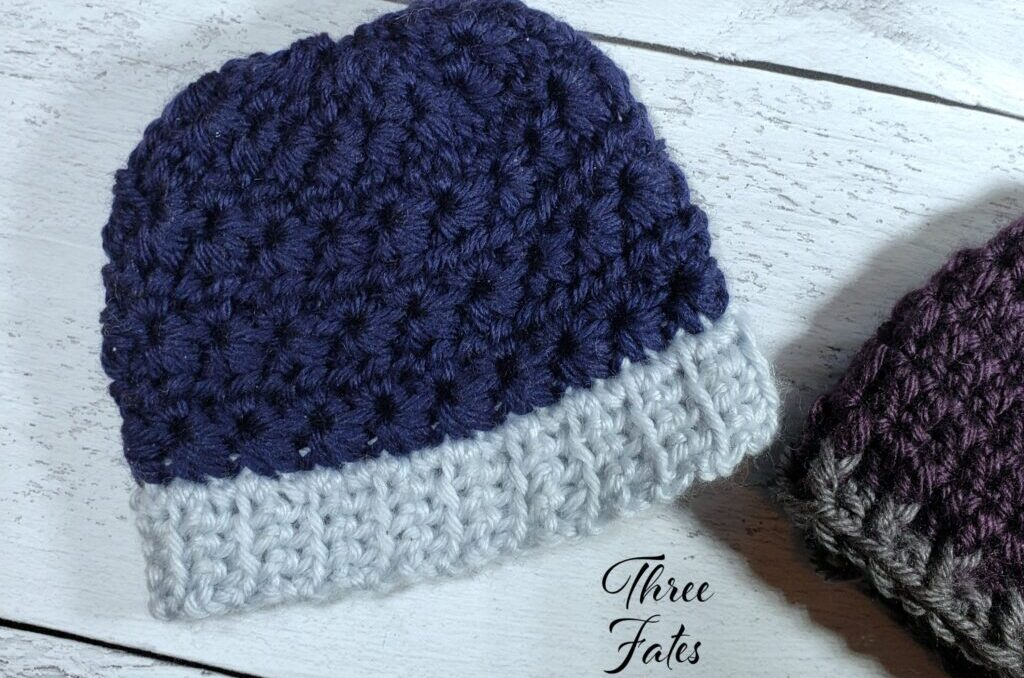 A navy blue crochet hat for a preemie.