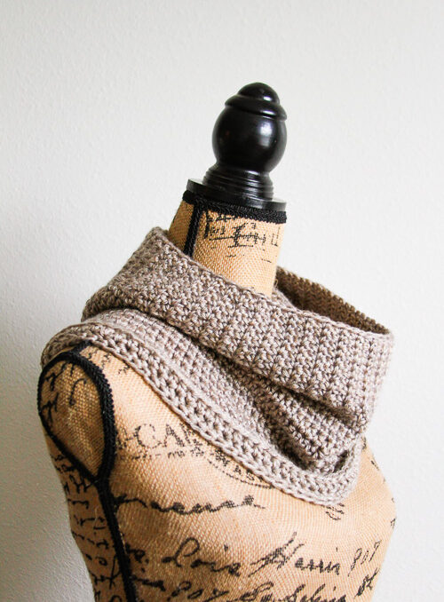 Side view of a slouchy crochet cowl pattern on a mannequin
