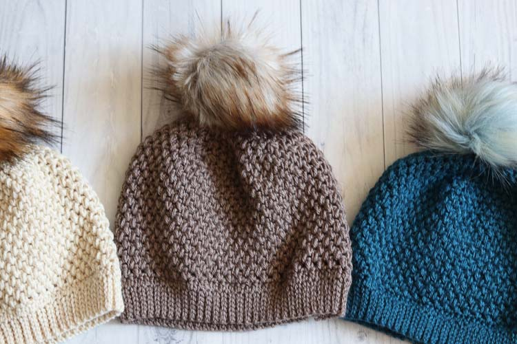 Crochet beanies made with the elizabeth stitch, ribbed brims and pompoms