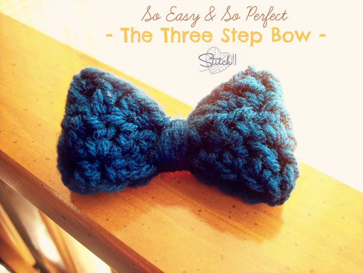 A crocheted bow made with blue yarn
