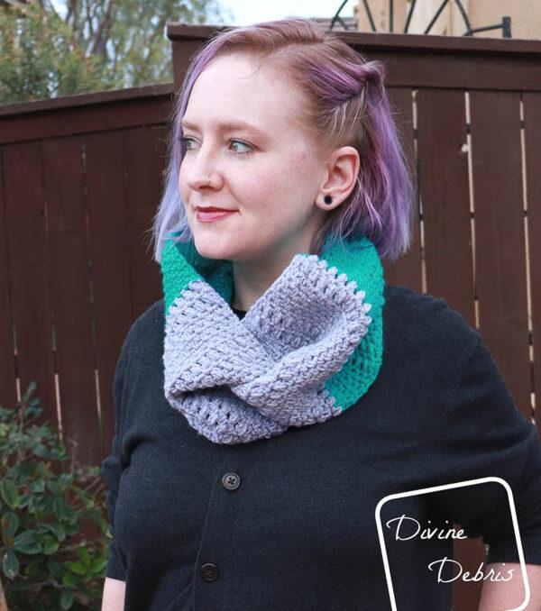 Woman wears a crochet cowl with a knot twist detail.