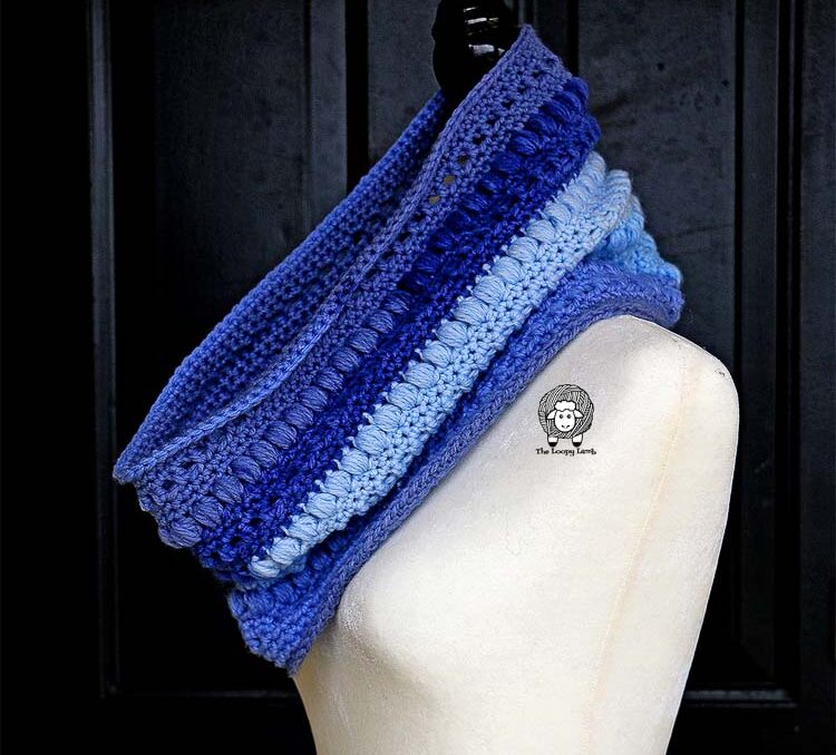 One skein of yarn was used to create this colorful crochet cowl displayed on the mannequin.