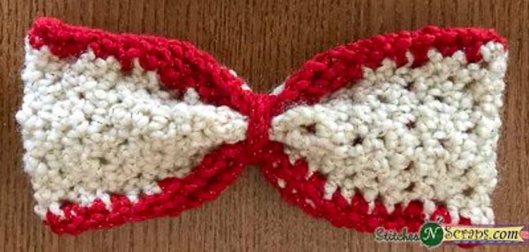 a red and white crochet seed stitch bow