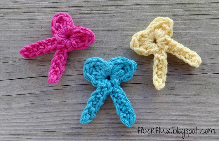 Pink, blue and yellow crochet bows.