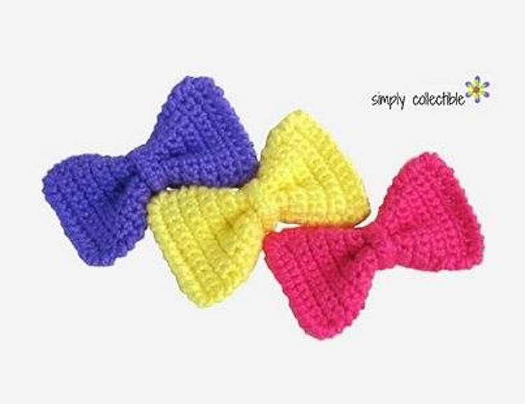 3 cute crochet bow ties in different colors on a white background