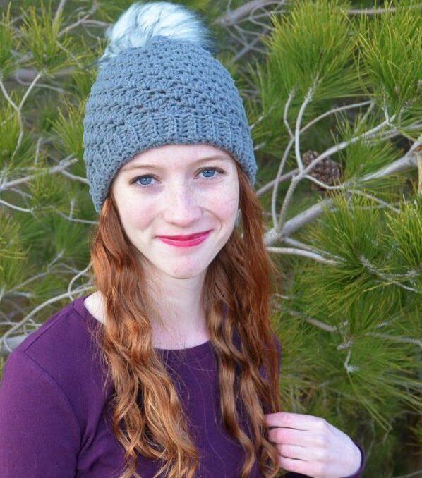 Woman wearing a crocheted beanie