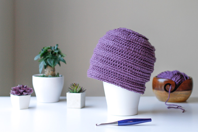 a purple chemo cap displayed on a table